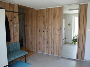 Eingangsbereich mit Wandverkleidung in Eiche massiv